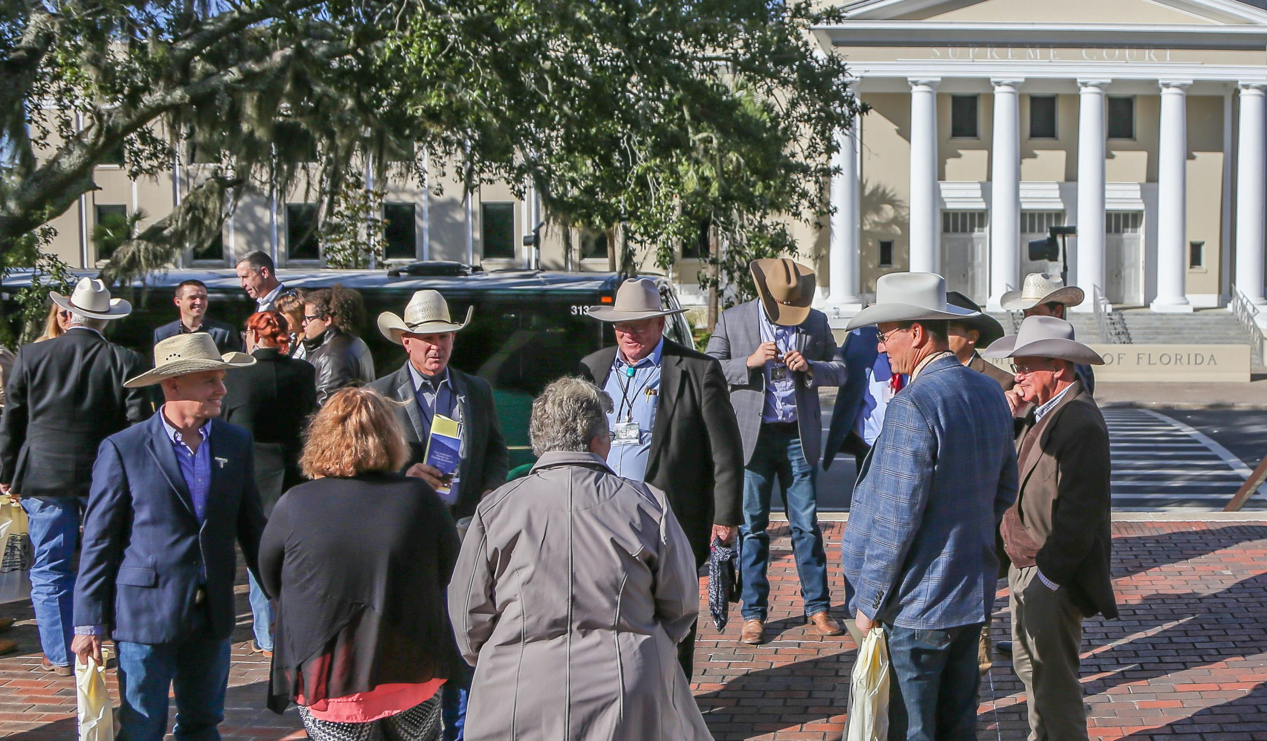 Men in cowboy hats outside Florida Capitol Complex