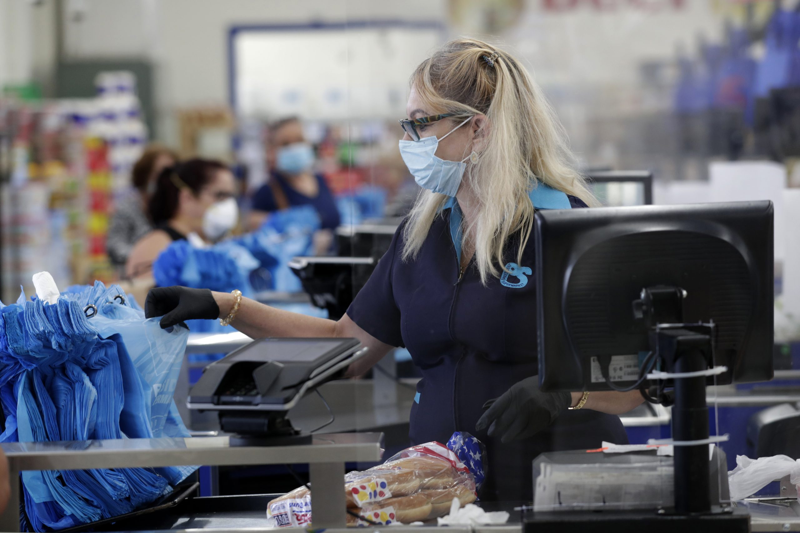 grocery cashier working with mask on