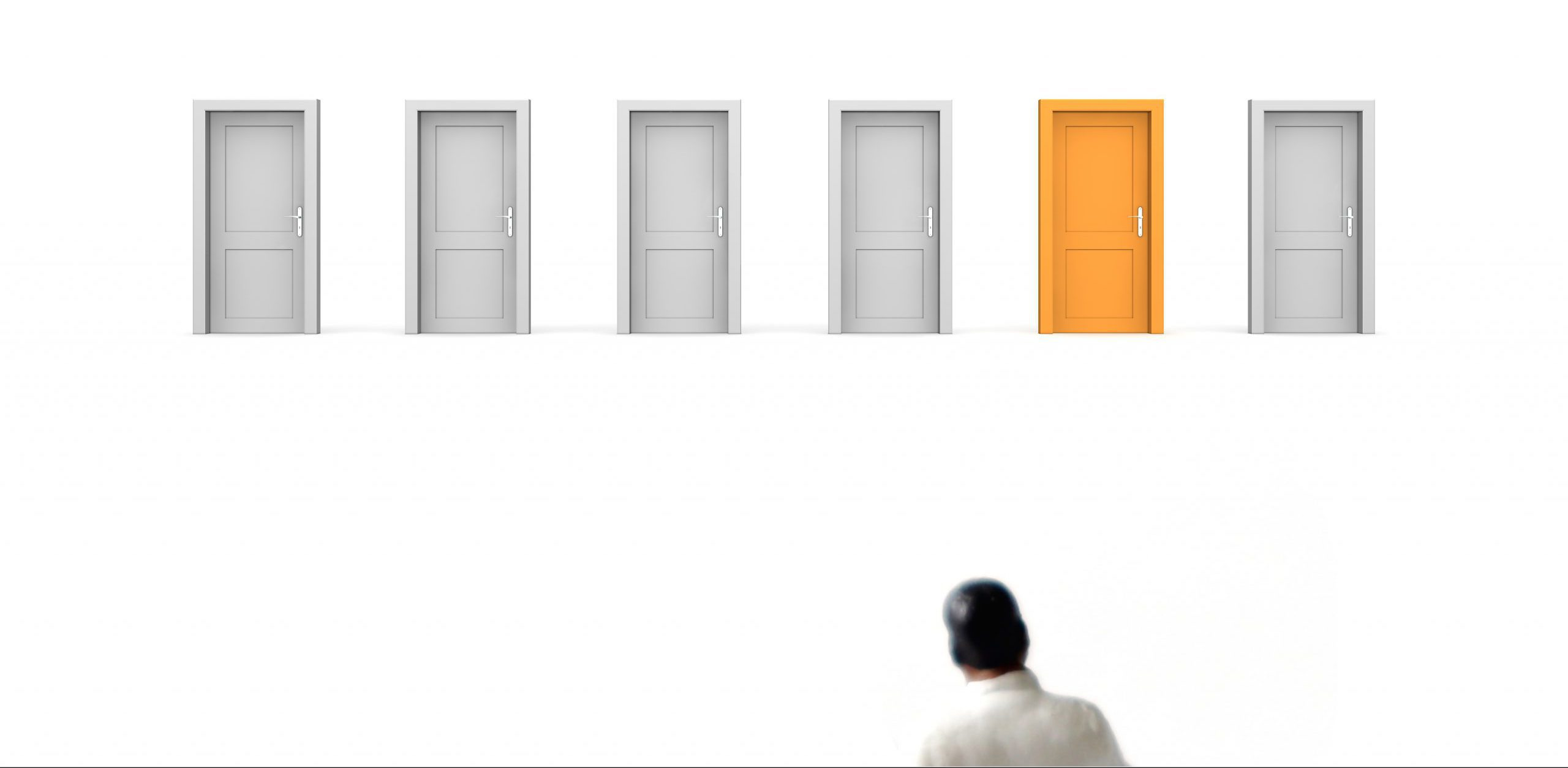 Man standing in front of closed doors